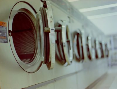 Row of washers at a laundry mat