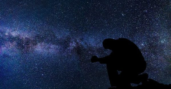 silhouette-of-a-man-under-the-stars-and-galaxy