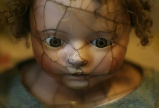 doll with broken face